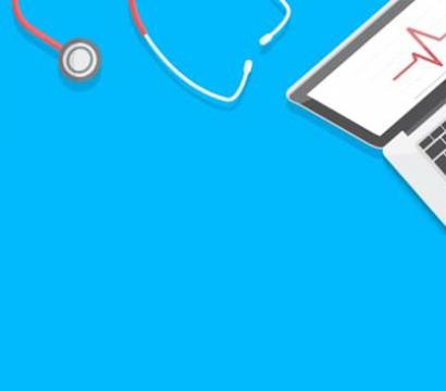 A computer and stethoscope on a blue background