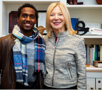 President Amy Gutmann with a student
